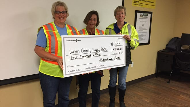 From left to right are Marla McElroy, Julia Sprague and Wendy Coyle, Plant Manager at International Paper in Henderson.