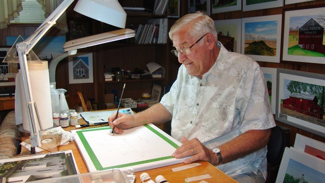Ernie Galajda paints in his workshop. The Coshocton resident discovered his artistic side after retiring.