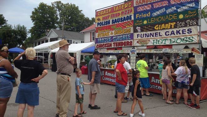 Folks line up for concessions at a past Charlotte Festival.