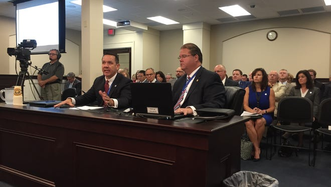 Kenton Commonwealth's Attorney Rob Sanders (left) and Warren Commonwealth's Attorney spoke Friday to the House-Senate Judiciary Committee about the impact of state budget cuts.