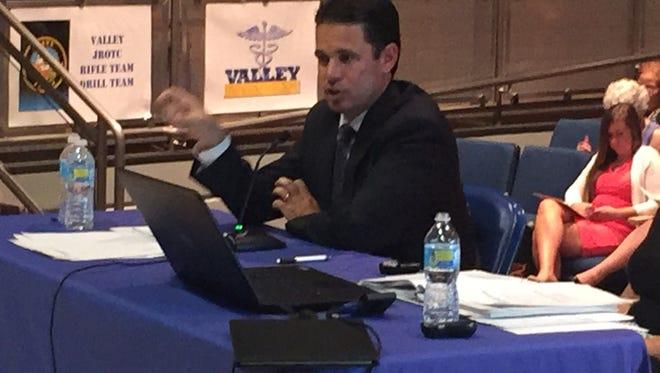 Jefferson County Public Schools acting superintendent Marty Pollio speaks to Kentucky legislators at Louisville's Valley High School.