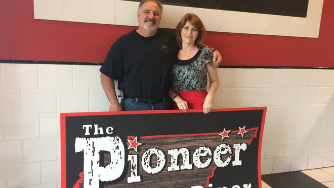 Chris and Crystine Carvalho get ready for the Wednesday grand opening of the Pioneer Diner in Pleasant View.