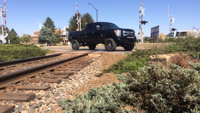 The city of Fort Collins is working out plans for repairing a railroad crossing on College Avenue near Cherry Street.