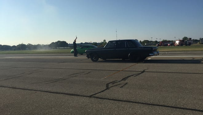 Cars take off during the first race of the night during the first Motor City Showdown drag races