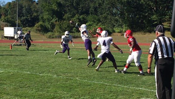 New Rochelle's Myles Taylor breaks up a pass in a 48-0
