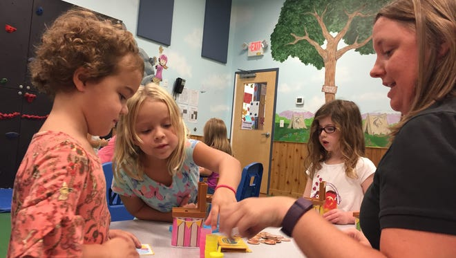 Mila Goodchild and Devyn Harper play a new game at The Goddard School in Hendersonville.