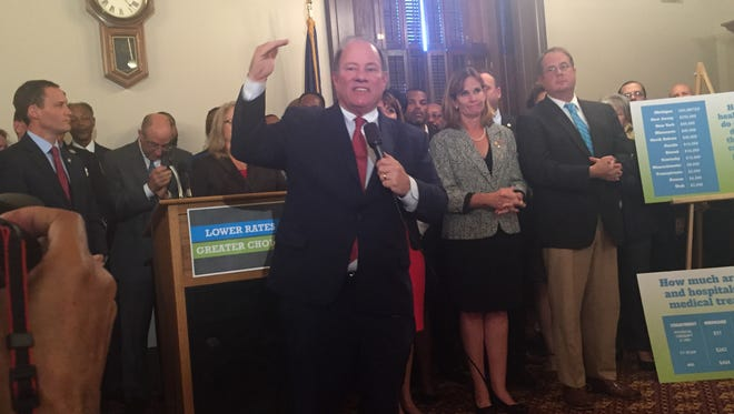 Detroit Mayor Mike Duggan appears at a press conference on legislation to drastically reduce auto insurance rates at the Capitol in Lansing.