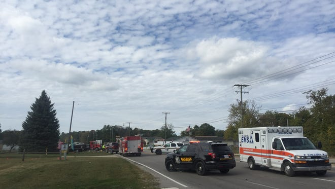 Rescue crews respond to a crash Wednesday on Lapeer Road just west of Wadhams Road in Kimball Township.