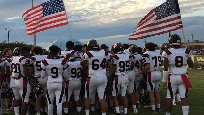 The Parkway football team carried American flags onto the field at Airline prior to Friday's game.