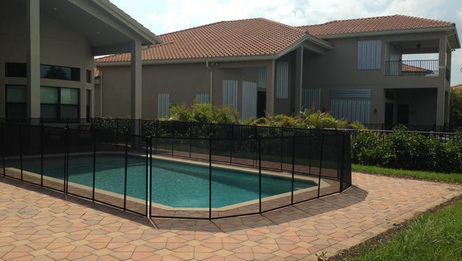 An example of a fence around a pool to serve as a safety barrier against accidental drownings.