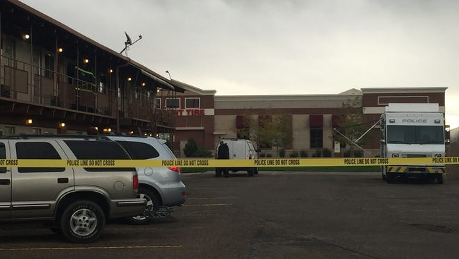 Police tape surrounds the area where a Fort Collins police shooting occurred early Sunday morning at America's Best Value Inn, 1809 N. College Ave.
