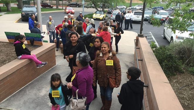 Residents stream into Fort Collins City Hall on in May to show support for a proposed Community Trust Ordinance, which would block city employees from asking about a person's immigration status.