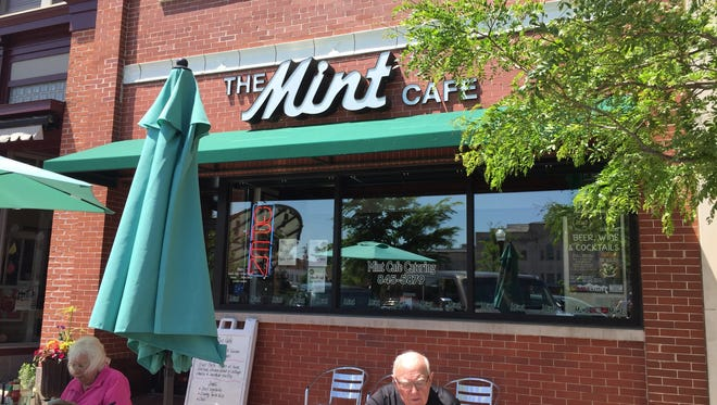Customers enjoy their lunch outside of The Mint Cafe, which has been open since 1888.