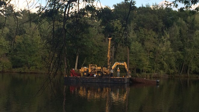 A barge on the Wisconsin River near Ben Hanson Park in Wisconsin Rapids. The barge is for the preliminary drilling work for the wastewater redesign planned for the west side of town.