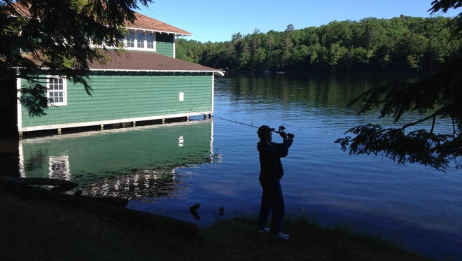 An angler makes a cast into a northern Wisconsin lake. Photo taken June 21, 2017 by Paul A. Smith.