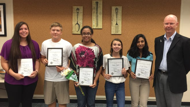The Exchange Club of Sebastian's September students of month are, from left, Veronica Espinosa, Corbin Berni, Serenity Pouncy, Madison Slapikas, and Fizza Alkhan, with Dr. Jeff Slade, club president.