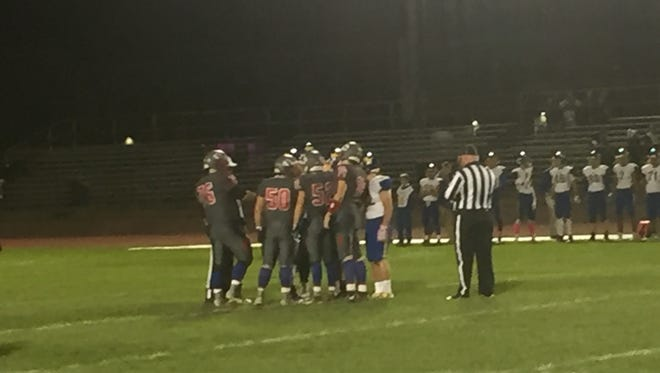 Captains for host Owego and Maine-Endwell meet at midfield for the coin toss Friday before their Section 4 Football Conference Division III game. The Spartans won, 26-6.