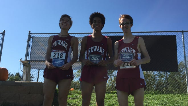 From left, Zach Gayheart placed sixth, Monte Street second and Bruce Davisson third to help Newark repeat its OCC-Capital boys cross country championship.