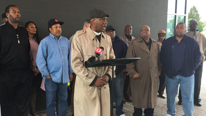 Rev. Charles Harrison, Ten Point Coalition board president, addresses media Oct. 15 in Tarkington Park to celebrate two years with no homicides in the Butler-Tarkington neighborhood.