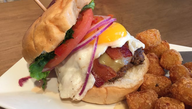 Burger Republic's Buy the Farm burger features smoked Gouda cheese, a fried organic egg, red pepper relish, applewood bacon, lettuce, tomato and red onion.