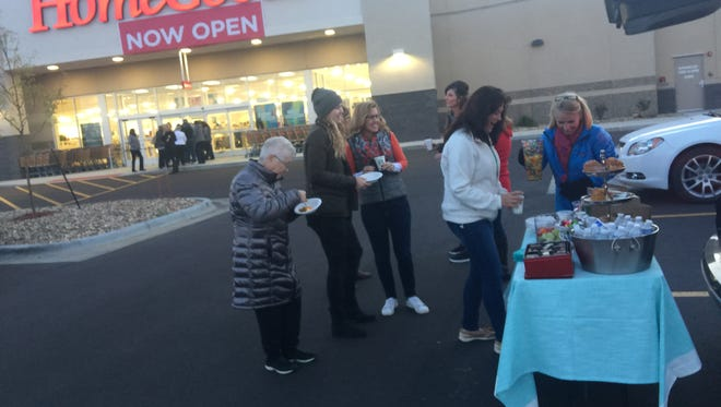 Cara Lovrien (right) and a group of friends tailgate with coffee and baked goods before the Thursday morning opening of HomeGoods in Sioux Falls. More than 20 shoppers were lined up by 7:45 a.m. for the 8 a.m. opening.
