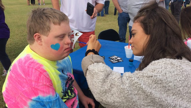 Tanner Goodrich gets his face painted at the Down Syndrome Association of West Tennessee's annual Buddy Walk in Jackson, Tenn. on October 21, 2017.