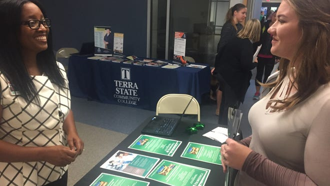 ProMedica recruiter Chelsea Dawson, left, talks to Terra State Community College nursing student Andrea Gosden Tuesday at the college's first Medical Career Fair.
