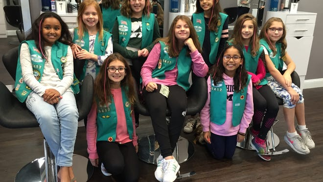 Members of Montville Girl Scout Troop 5417 recently got pink hair extensions at Salon I Am on Changebridge Road in Montville to raise awareness for breast cancer. All proceeds went to breast cancer research. Pictured from left are Shruthi Swaminathan, Brooke Kurinec, Brooke Misiora, Aviva Rappaport, Ashley Failia, Ines Lemee, Anushka Agarwahl, Lauren McPhail and Evelyn Susnosky.