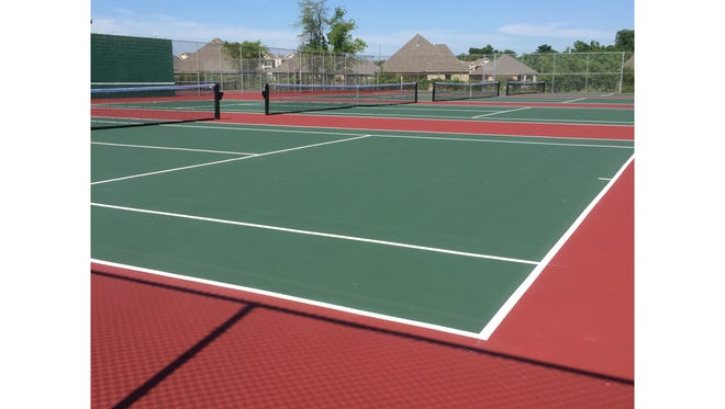The tennis courts at Caddo Magnet High School have undergone a $60,000 resurfacing project.
