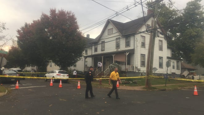 Police officers and residents at the scene of a shooting reported Thursday afternoon at Third and Center streets in Somerville.
