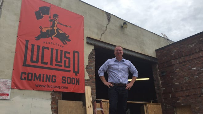 Aaron Sharpe in front of the site of the future Lucius Q restaurant in Pendleton.