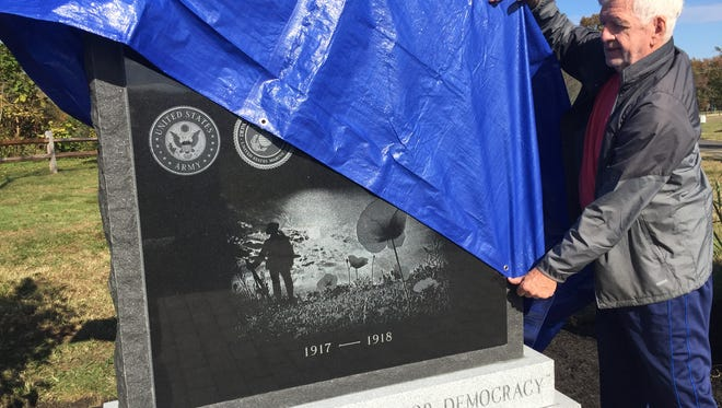 Burlington County World War I Memorial Committee volunteer Ed Holland checks the new and first monument to the 89 county residents killed in action in that war. A public dedication will be 10 a.m.Saturday in Freedom Park, 86 Union St., Medford.