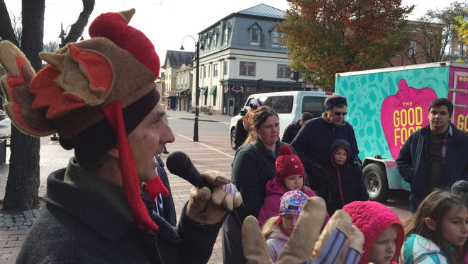 Rob Meehan, director of the Chittenden Emergency Food Shelf, addresses the crowd Saturday at the fourth-annual Trotting of the Turkeys on the Church Street Marketplace.