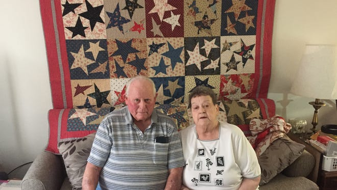 Sam and Carole Slaymaker sit in front of a Quilt of Valor Sam was presented a few years ago. The longtime Marengo residents and community volunteers have stepped down from their leadership roles with the Marengo American Legion this past fall.