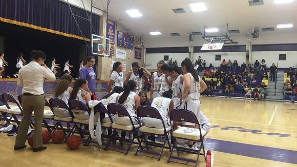 The Burges girls basketball team gets instructions from the coaching staff during Tuesday's win vs. El Dorado at home.