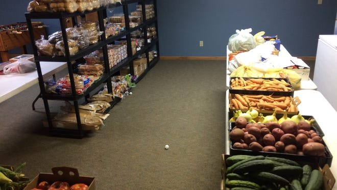 The food pantry at Covenant Community Presbyterian Church offers a wide variety of items, including fresh vegetables and bread.