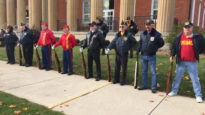 Members of the Honor Guard stand in front of the Sandusky County Courthouse during a Veterans Day ceremony organized by VFW Post 2947 in Fremont.