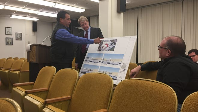 Cape May Foods LLC on Monday night presented its Gorton Road factory expansion plan to the Millville Planning Board. Daniel LaVecchia, managing member for the company, points out details of the plan as a witness for company attorney Arnold Robinson (standing, enter). On right, Vice President Michael LaVecchia watches. The plan was approved.