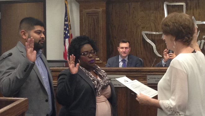 Wichita Falls City Councilors Mitesh Desai, District 5, and DeAndra Chenault, District 2, are sworn in Tuesday during a special council session. Desai is new to council and Chenault is returning for a second term.