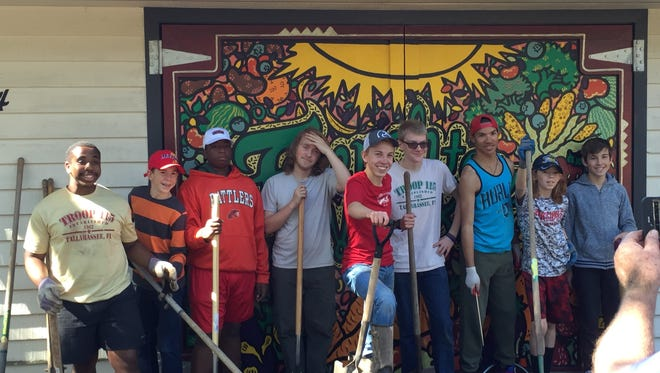 Colin McGorty, center in red shirt, helped build a rain garden for his Eagle Scout project.