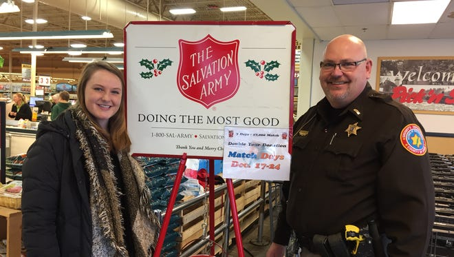 Door County Sheriff's Lt. Bob Lauder and his daughter Chelsea volunteered to help the Salvation Army during its annual holiday donation drive.