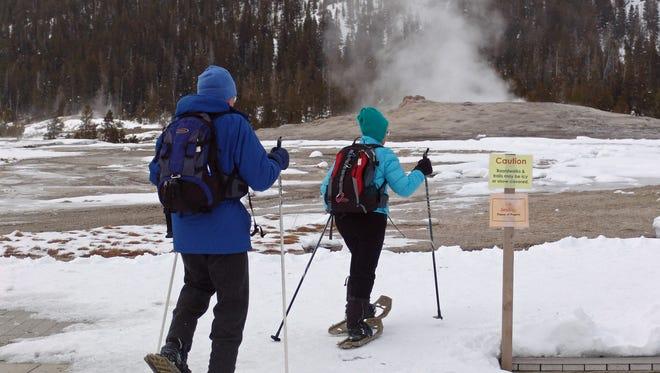 Lee and Kathy Larson of New Hampshire snowshoe around Old Faithful.