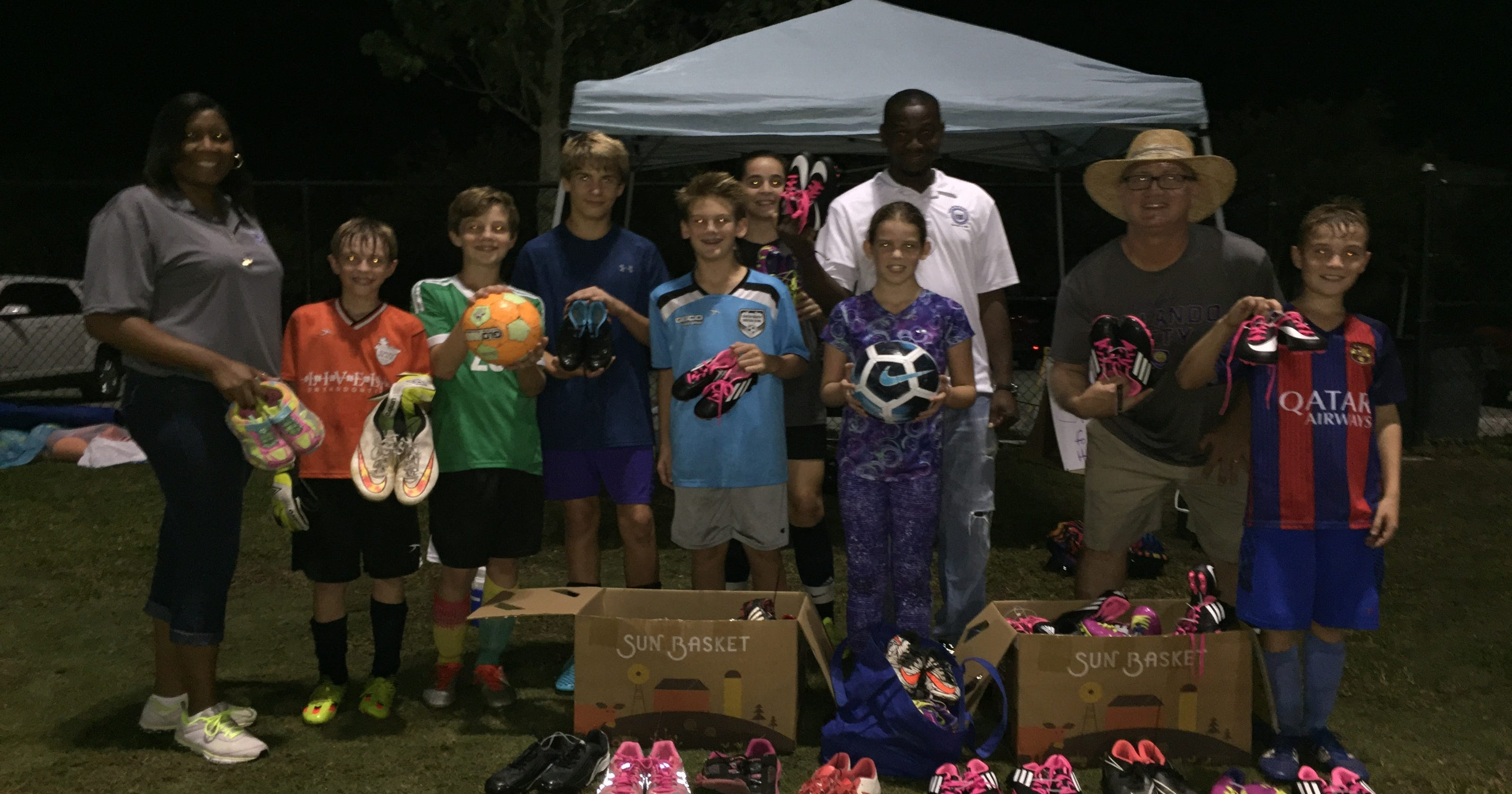 a352e785e U14 team collects 100+ pairs of shoes