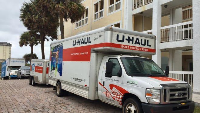 Moving trucks line the Versailles Sur La Mer condominium complex driveway Thursday morning south of Melbourne Beach.