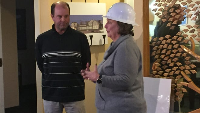 Chris Hoff, left, the director of the Barracuda Championship, made a donation to the veterans Guest House in Reno this week. Noreen Leary, right, is the CEO of the veterans Guest House.