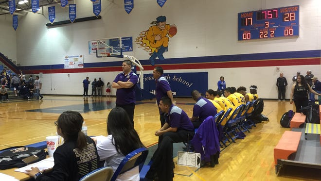 The Burges boys basketball coaching staff gives instructions to players on the court on Saturday at Americas.