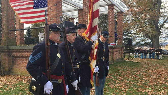 The 11th Pennsylvania Volunteer Infantry and Drum Corps Color Guard stand in front of the crowd after the presentation of the colors at Dedication Day, Nov. 19, 2017.