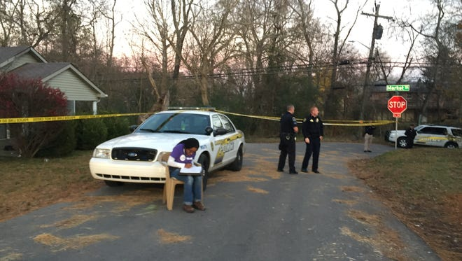 Police investigate a shooting on Mitchell Street on Monday, Nov. 20.