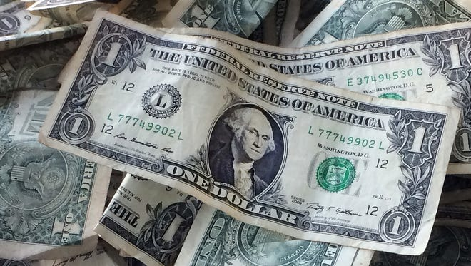 Legislation signed Monday, April 1, 2019, raises New Mexico's hourly base wage gradually from $7.50 to $12 in 2023. The first increase to $9 an hour begins at the start of next year.