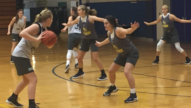 Working on defense during practice, the Lancaster girls basketball team hopes to improve on its 8-15 record from a year ago. The Golden Gales open the season against at home against Logan.